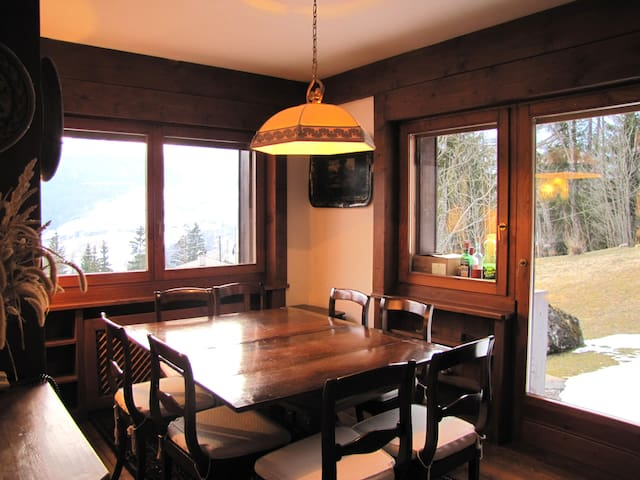 Dining area overlooking a clearning with possible view of deers
