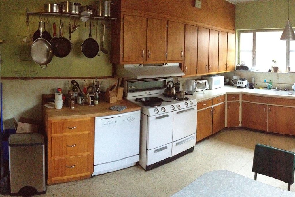 A large eat-in 1950s style kitchen.