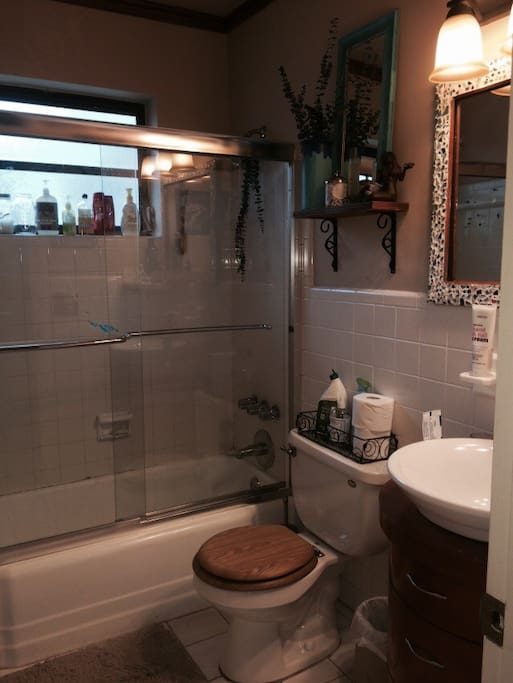Private bathroom with shower and small tub