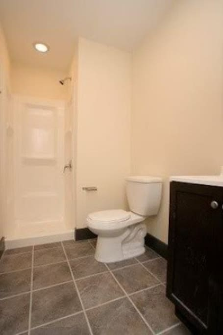 Full tile bathroom complete with shower and sink (all soaps and shampoos included)