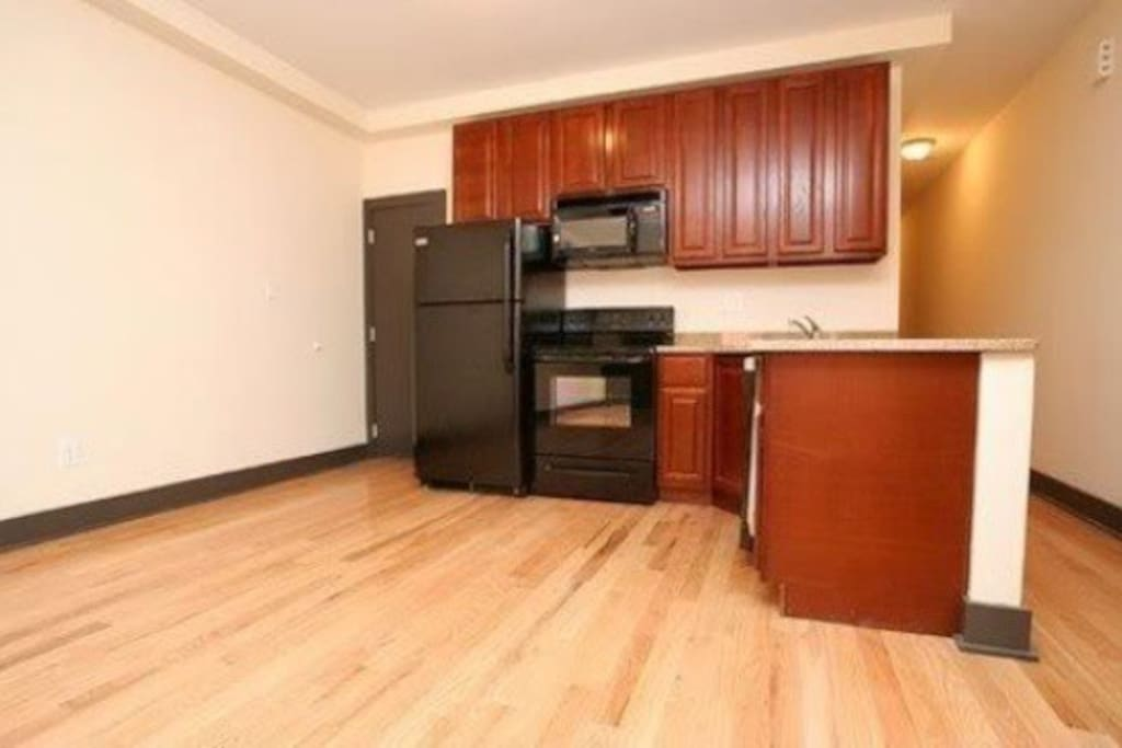 Large complete spacious kitchen with granite countertops