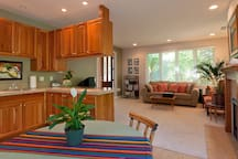The guest house is equipped with a kitchen, granite counters, a casual dining area, living room and gas fireplace.