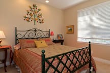 The second bedroom can accommodate twin beds or a queen and has two large windows that create a cheerful atmosphere.
