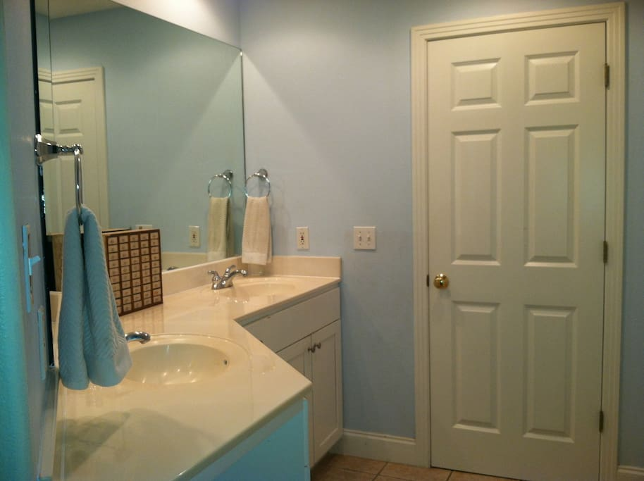 Master bath.  Through the door is a bathtub and separate shower.