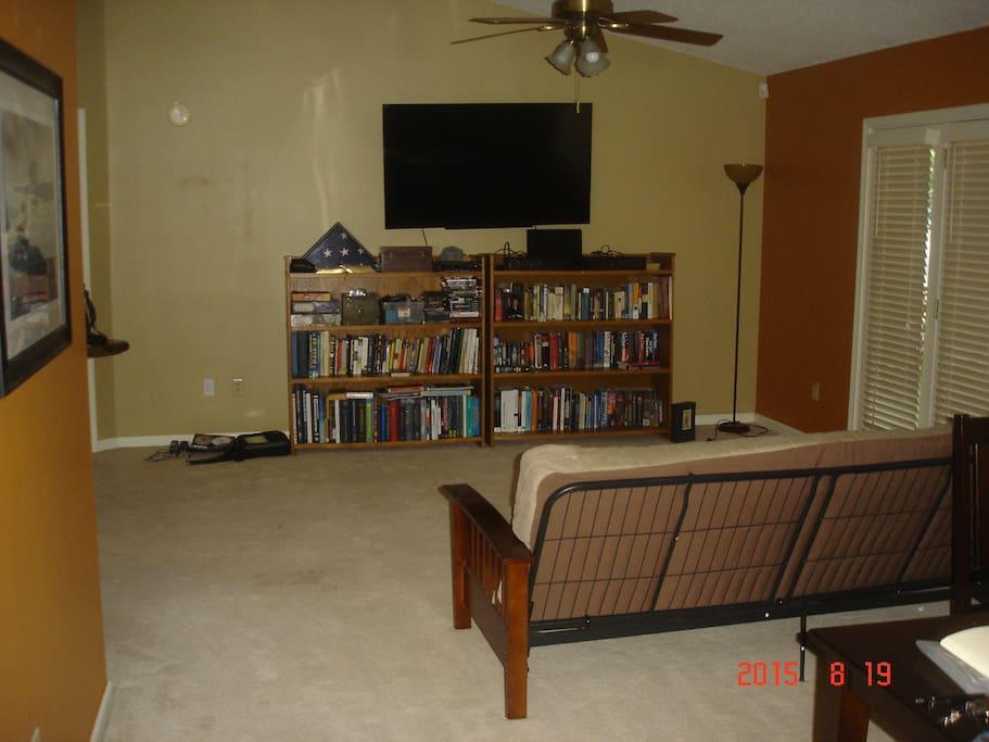 "Living room, 60"" TV, loads of books"