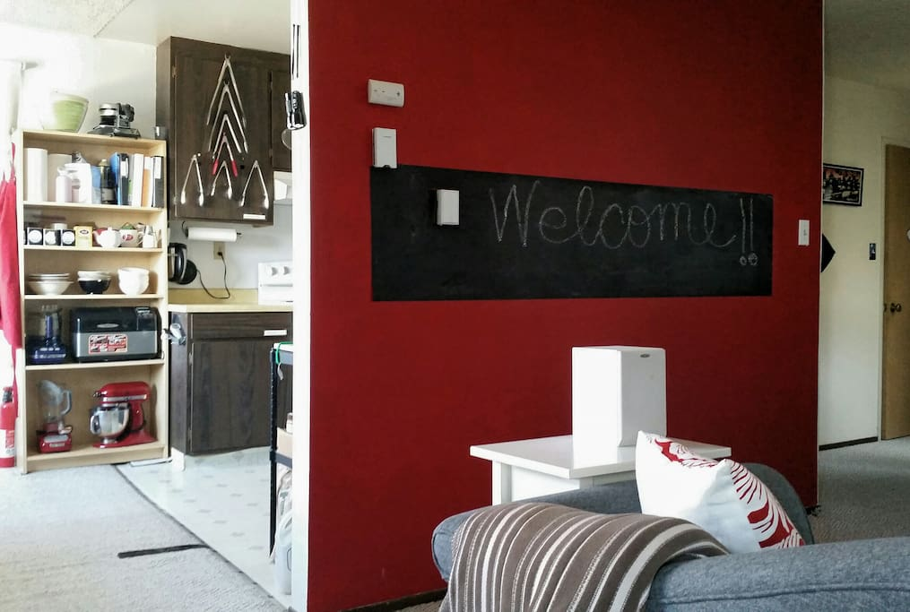 In the living room we have a chalkboard portion of the wall where you can share notes or allow kids some creative license.