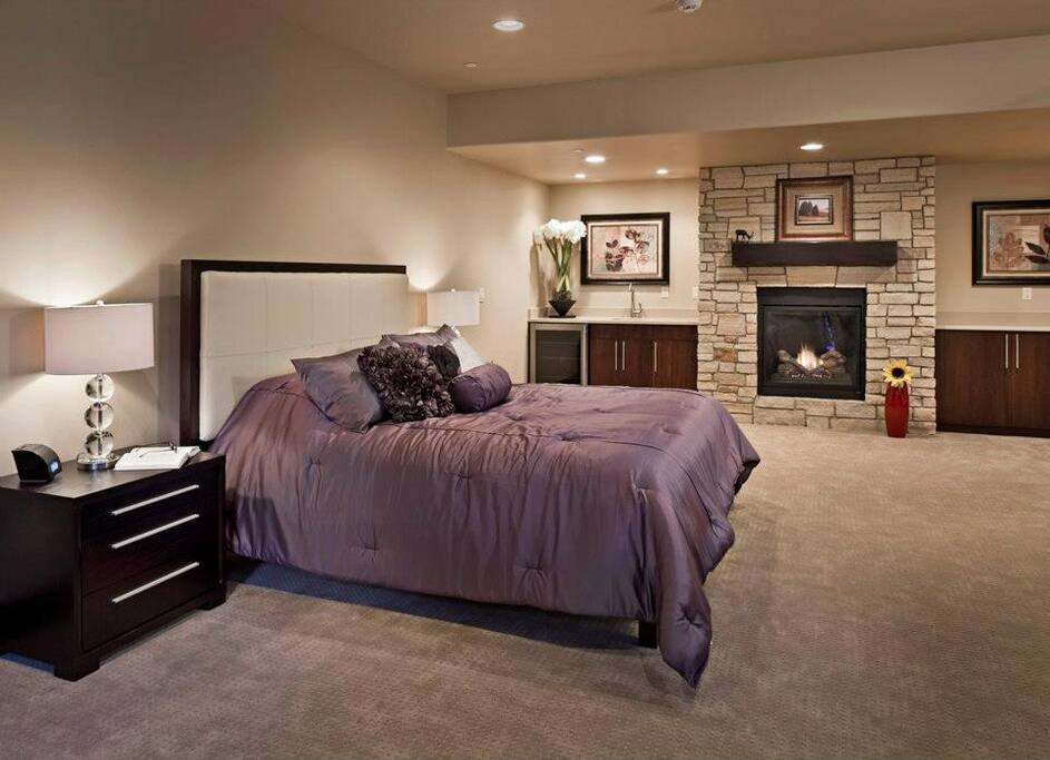 Master Suite with private bath, wet bar, gas fireplace, and tv