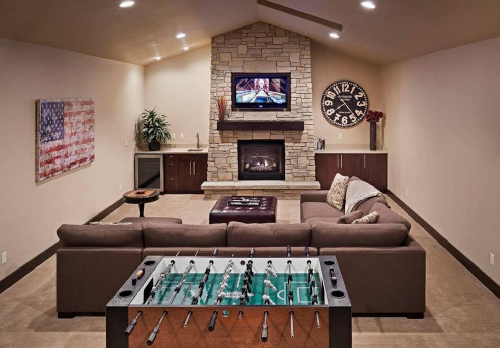 2nd Living room with Foosball table, wet bar, gas fireplace, and tv