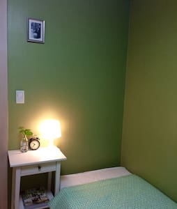A cozy, clean and quite green room