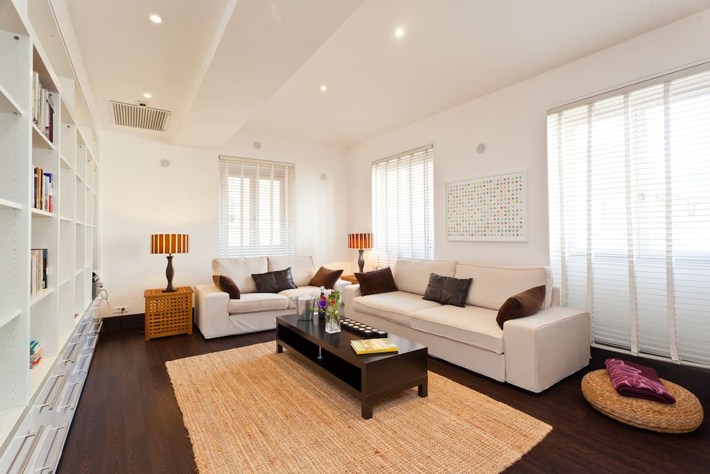 Enormous 8m x 5m living room.  Bright and airy from massive windows on a high floor looking out over the rooftops.