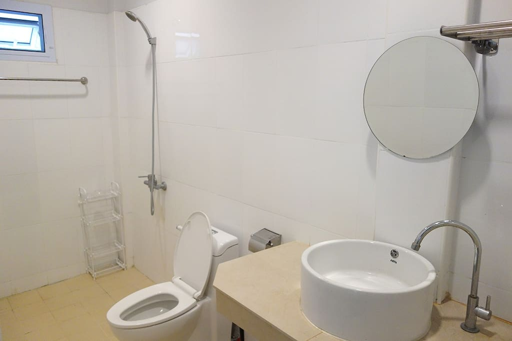 The bathroom with hot water and flush toilet
