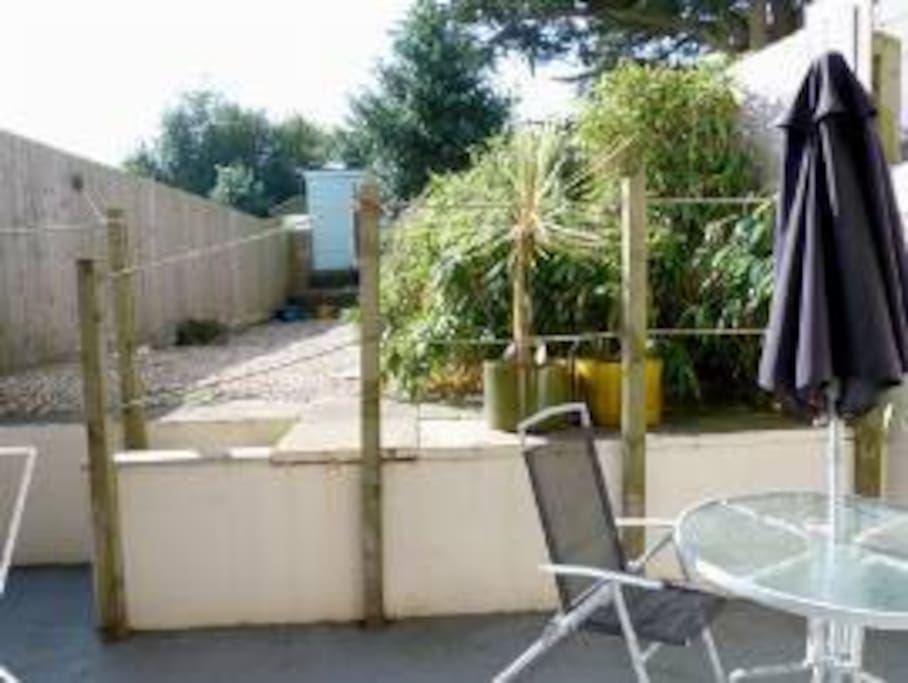 Rear garden, patio & pebbled area.  Dining table & chairs