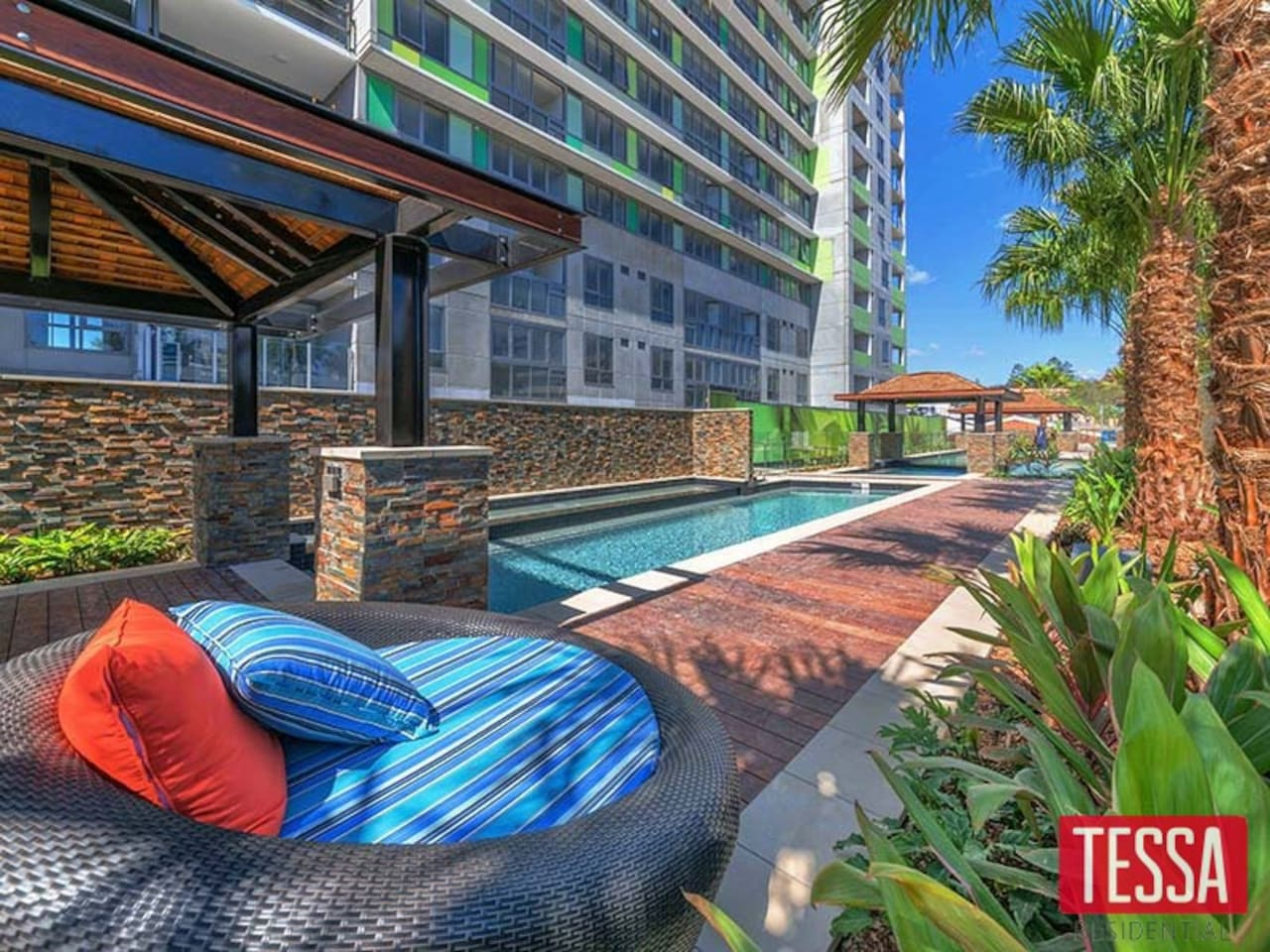 Stunning poolside entertaining/relaxing area with lap pool and wade pool and private sand strip