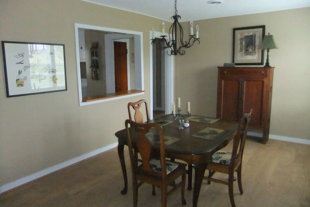 Dining room with antique table, chairs and chest