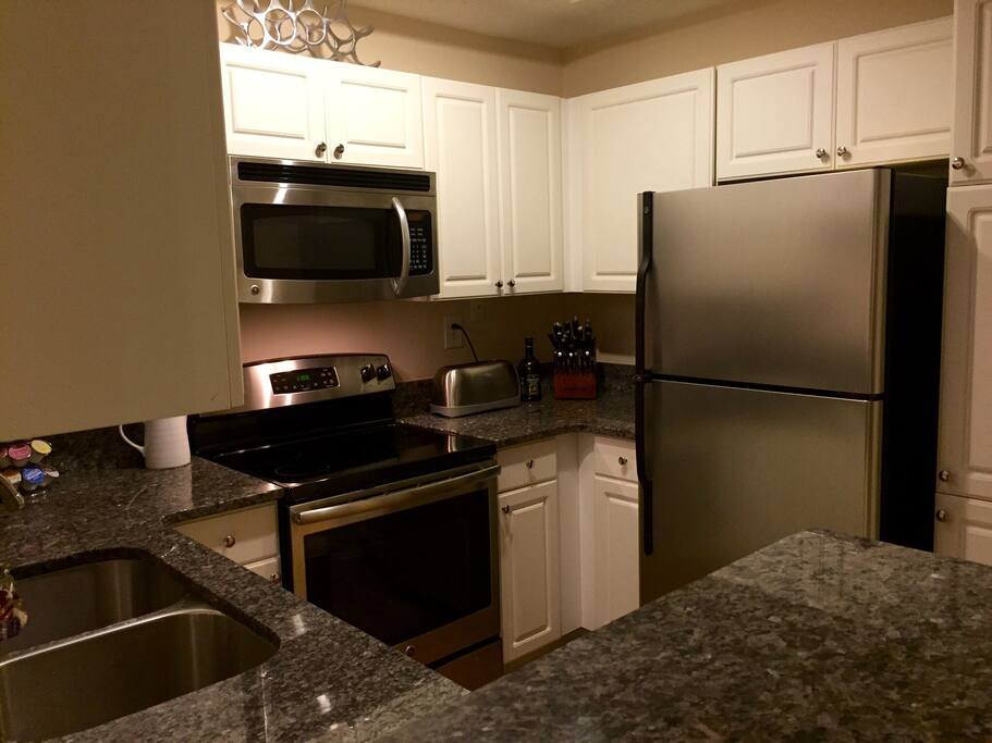 Kitchen. Stainless Kitchen appliances and beautiful marble kitchen counters.