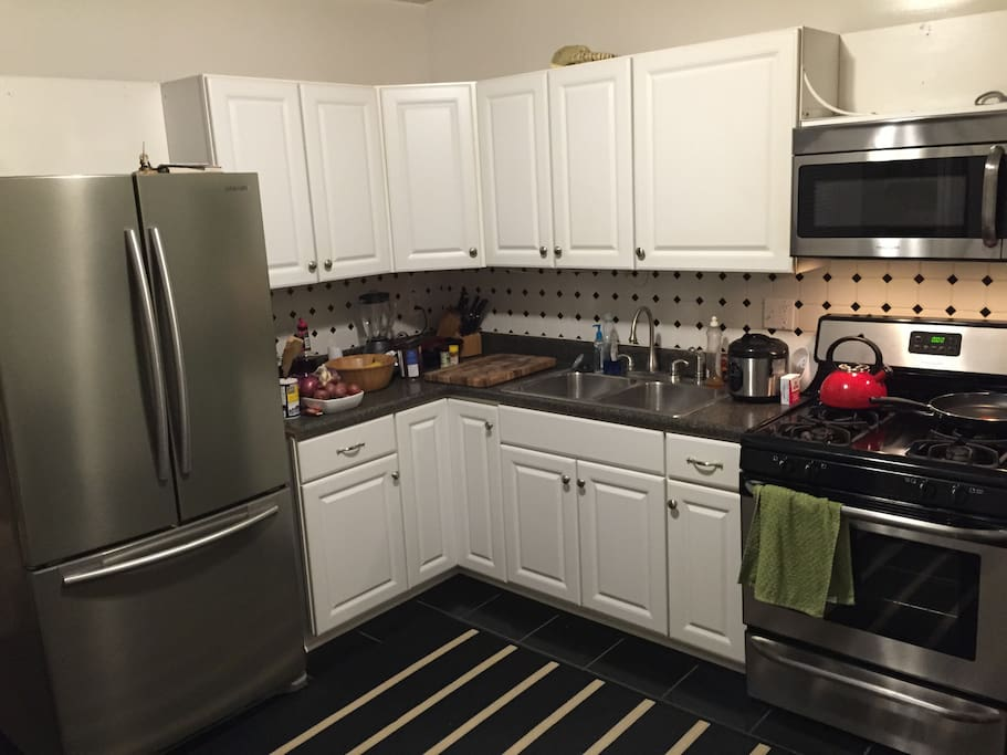 Kitchen includes, oven, microwave, dishwasher, blender, panini maker and more