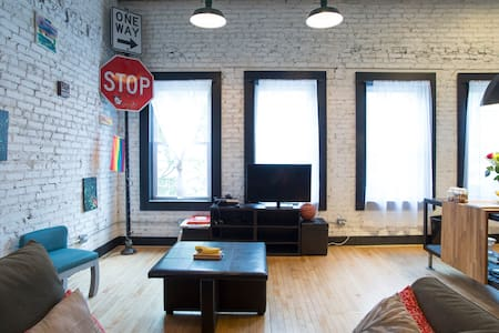 The loft is located in the heart of the Pilsen neighborhood in Chicago.  We are steps from trains and buses. You will have your own cozy private room along with complimentary toiletries, a stocked 'fridge, and hosts with great knowledge of the city!