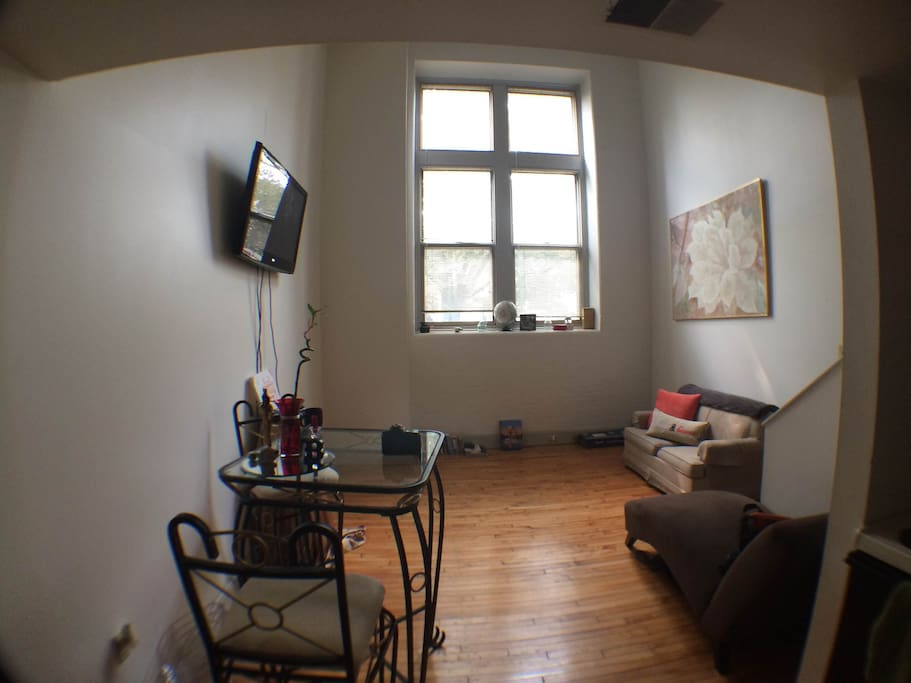 Open space!  *Plenty of natural light -Hardwood Floors -Twin bed sofa couch