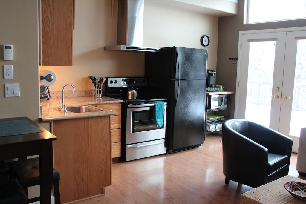 Fully appointed kitchen with full size refrigerator and stove/oven