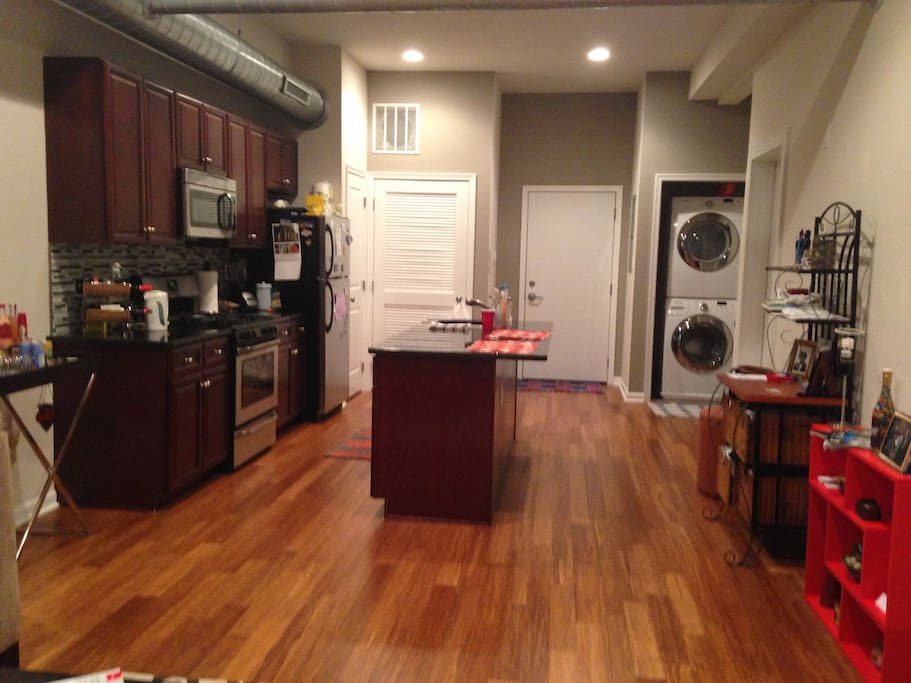 Living Space features a dishwasher, microwave, and washer and dryer for covenience