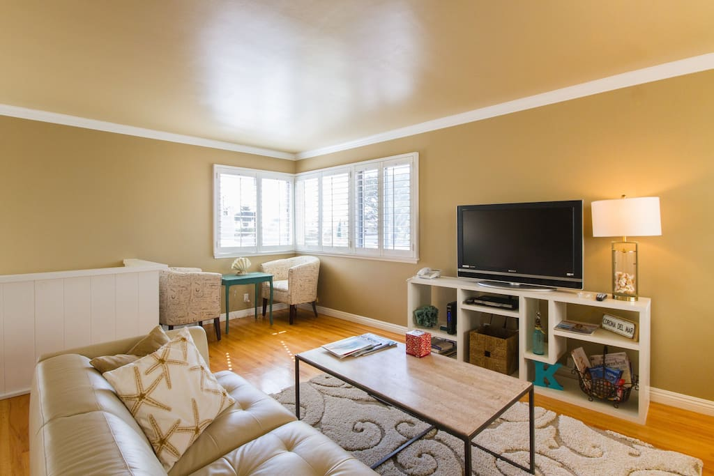 Your upstairs apartment features a spacious living room flooded with sunshine.