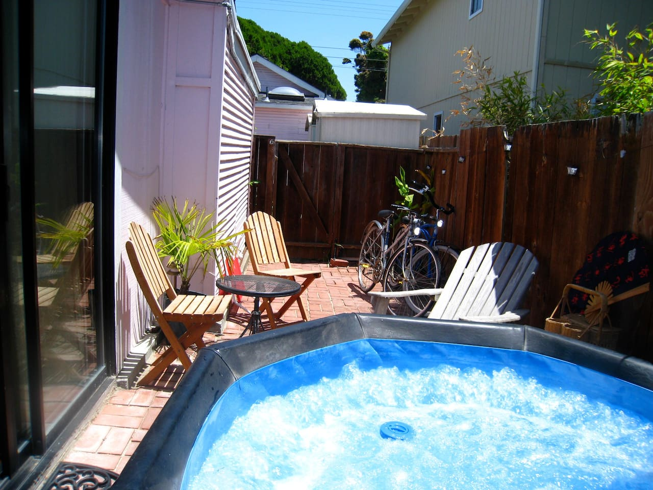 Private bubbling hot tub in your own private enclosed patio