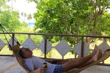 Sleeping on the hammock is another past time after a day of snorkelling or swimming .
