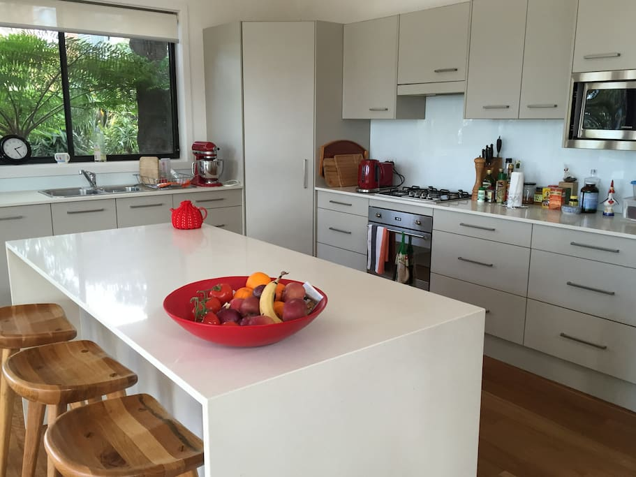 Modern kitchen with smeg oven, dishwasher and everything you need to cook a feast.