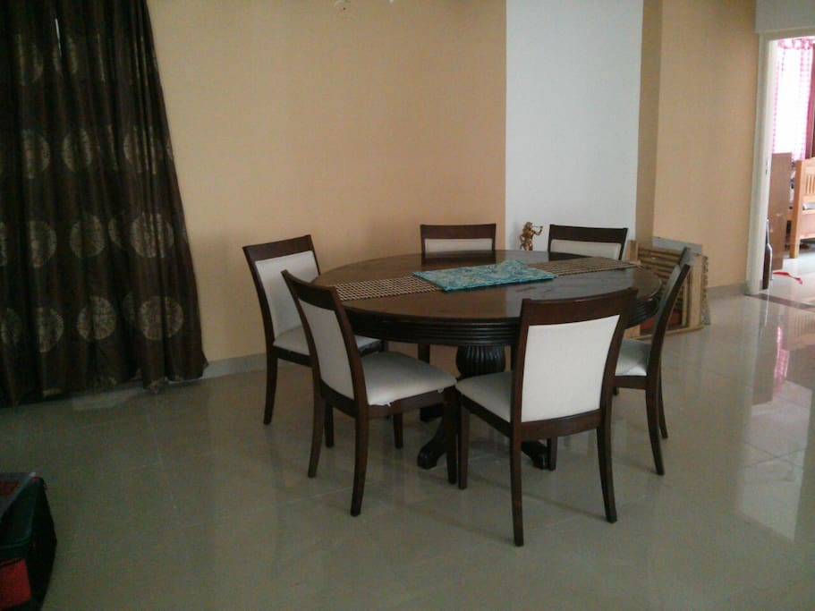 dining room, six seater dining table and diffused lighting