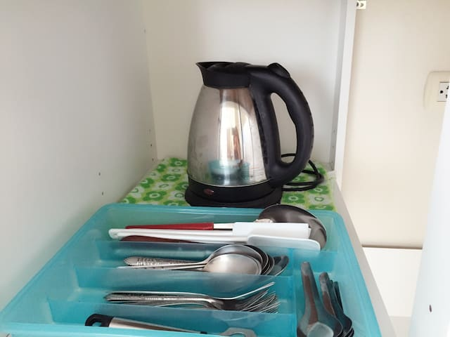 Hot water electric jug and ample spared utensils at your service in-room.