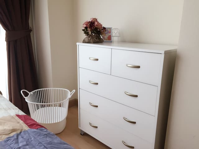 Multiple drawers & clothes basket in the bedroom