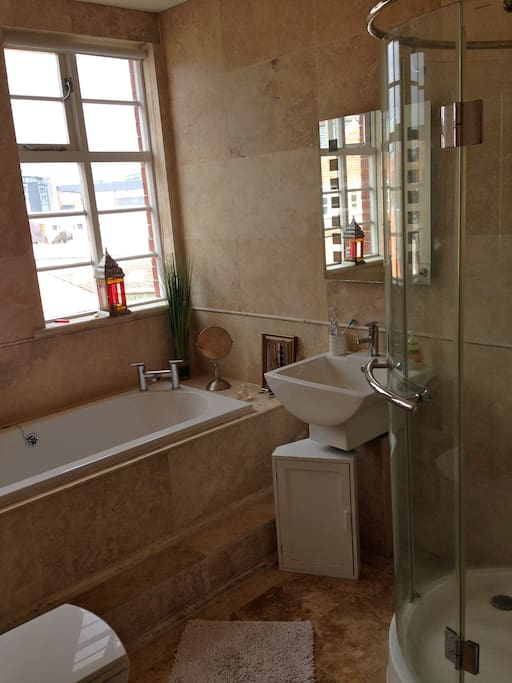 Bathroom with shower and bath tub (we'll need to share)