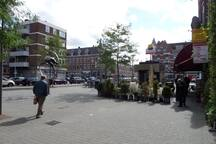Eveningstore, restaurant and metrostop Delfshaven in front of our house..