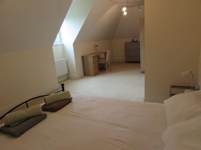 Large bedroom with plenty of space to work and relax