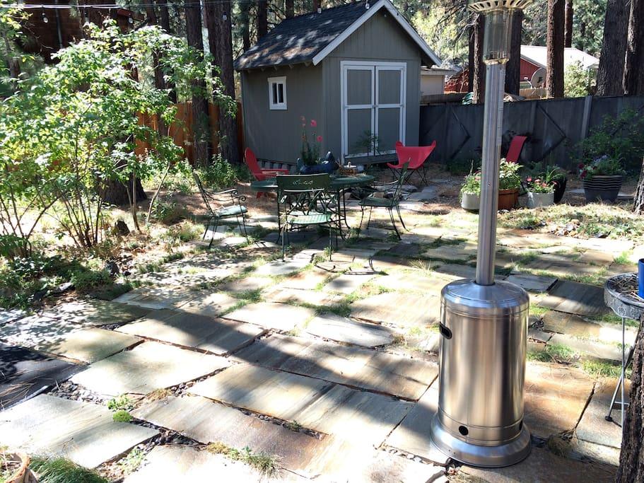 Stone patio backyard with BBQ.