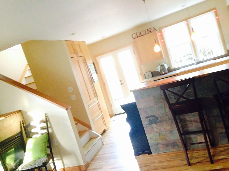 Bright, open kitchen and living area with bar and updated applicances.