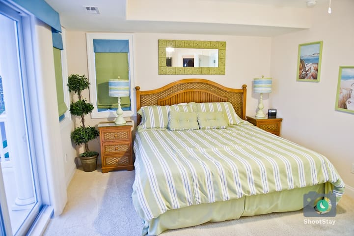 3rd Floor bedroom #7 w/ King size bed, balcony , walk in closet and private bath