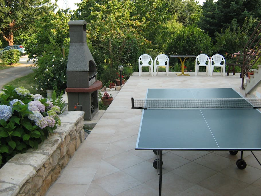 Ping-pong table and grill on shared terrace