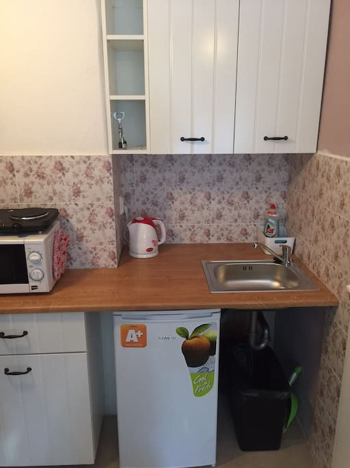 New kitchen in romantic design, microwave, two piece cooker, fridge, kettle
