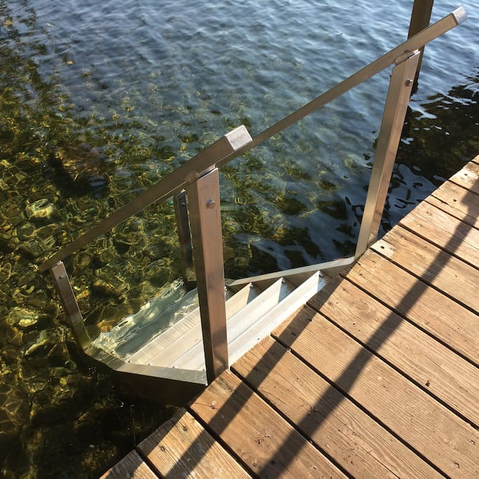 Steps from the dock into clear blue lake water
