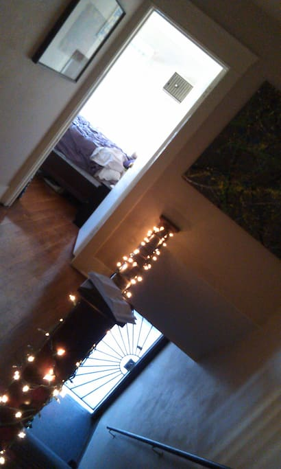 up the stairs from the front door and into the bedroom ;)