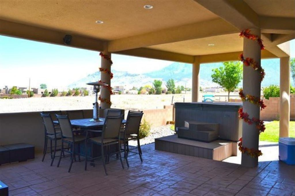 Back patio with a spa looking back at the Sandia Mountains.