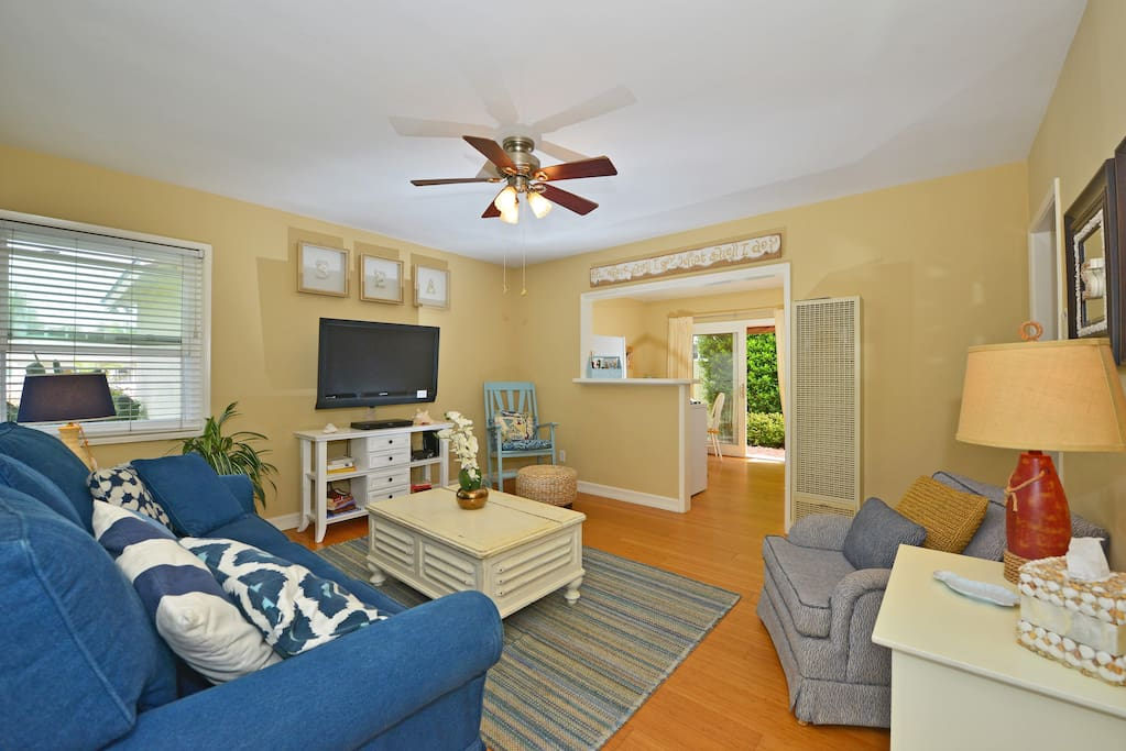 Comfy and casual living room with large flat screen TV for family movie night