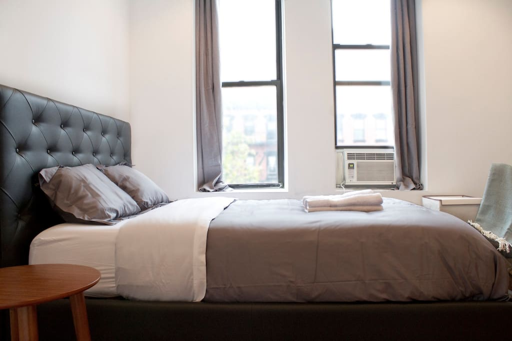 Master bedroom is serene and light filled, with views of a major NYC avenue. Both queen beds in the apartment have comfy tempurpedic mattresses.