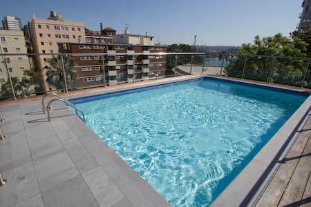 Sun Filled Studio with Rooftop Pool