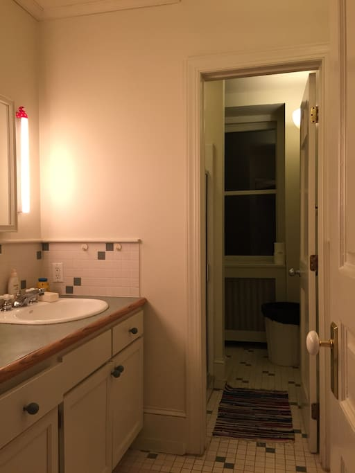 Shared bathroom with separate shower/toilet area.