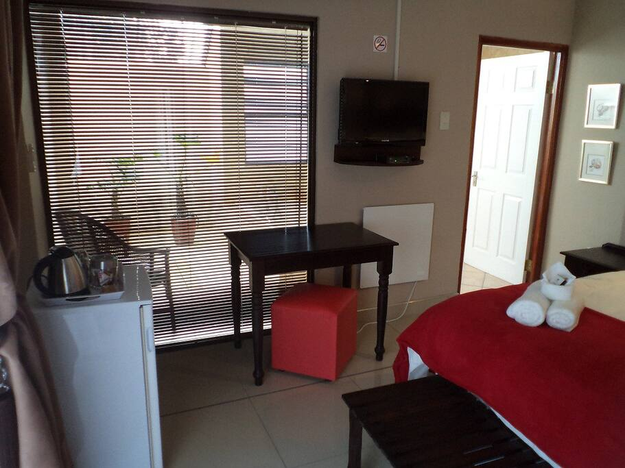 Bedroom with fridge, Satellite TV and Tea/Coffee facilities