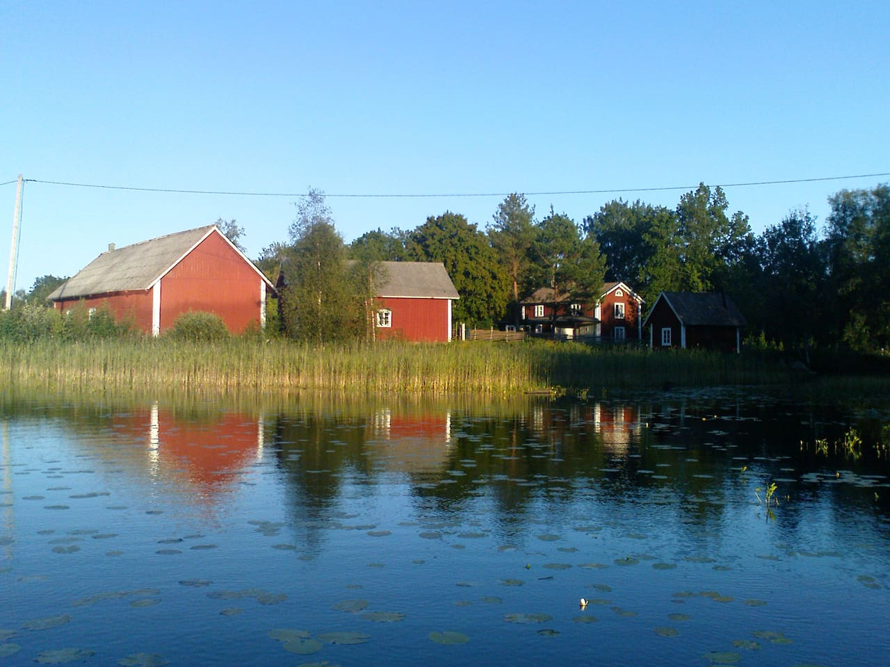 The lake is right next to the house offering both fishing and boating activities.