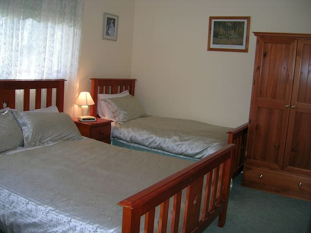 Second bedroom with queen and single beds
