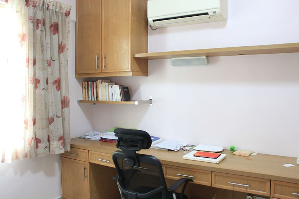 Private aircon bedroom with desk and wardrobe
